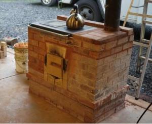 The Cabin Stove 2.0, door hardware still being developed. Photo by Matthew Remine, www.walkertsoves.com.